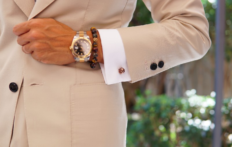This is how to wear cuffliks: the decoration is on the outside